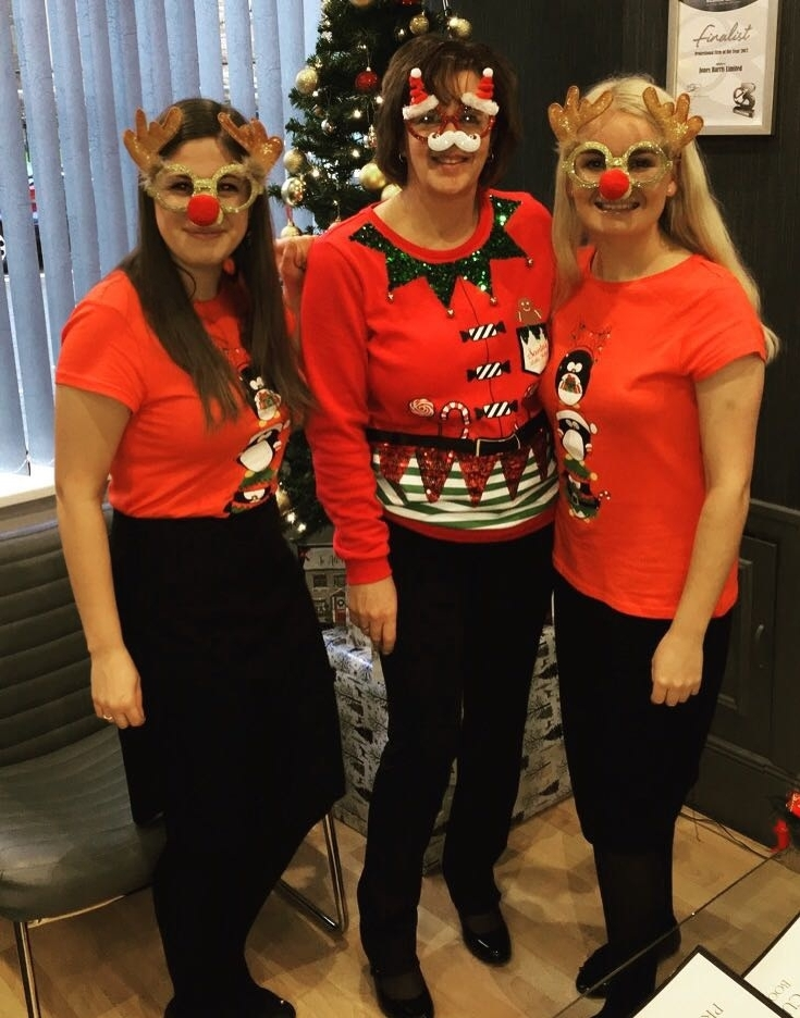 Group of reception staff at Jones Harris on Christmas Jumper day
