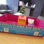 Staff at Jones Harris like the sweet taste of charity - The empty Donna's Dream House biscuit box