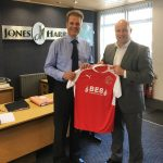 Head of Commercial at Fleetwood Town FC Martin Booker shakes hands on extending the partnership with Martin Wigley at Jones Harris Accountants premises on St Peters Square Fleetwood.